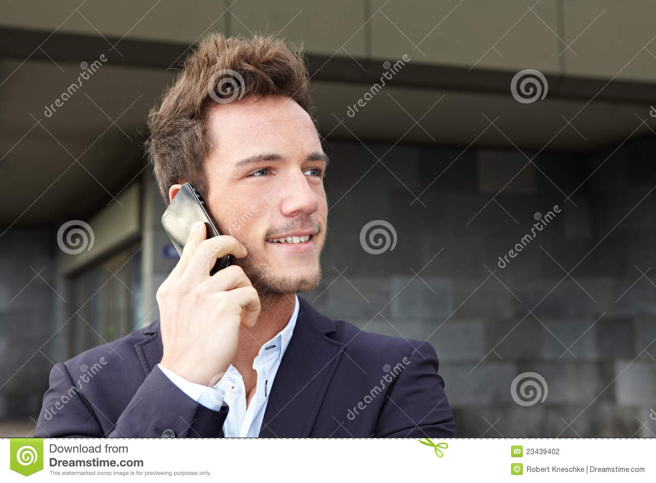 Business man making cell phone call