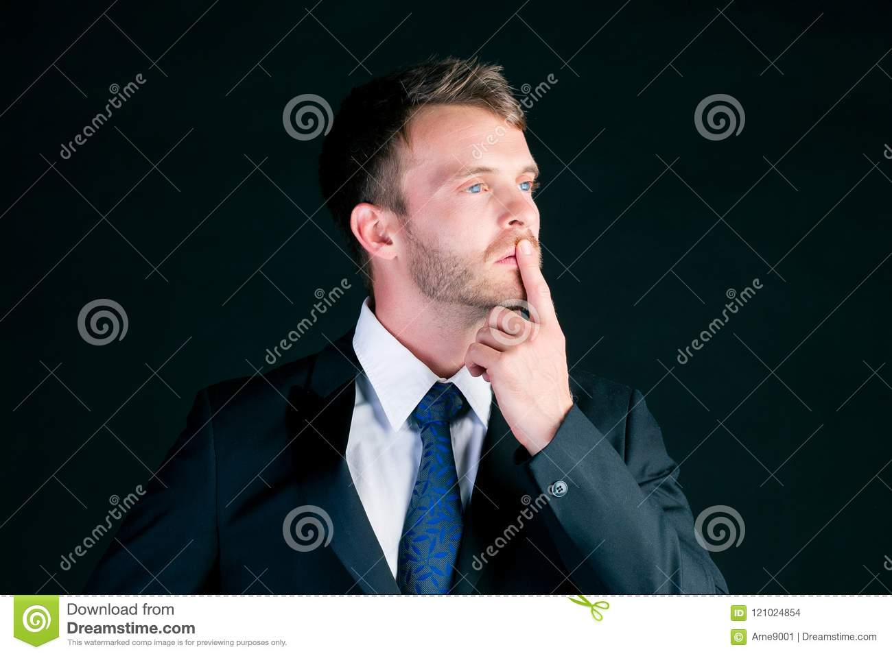 Man or manager in suit thinking concentrated