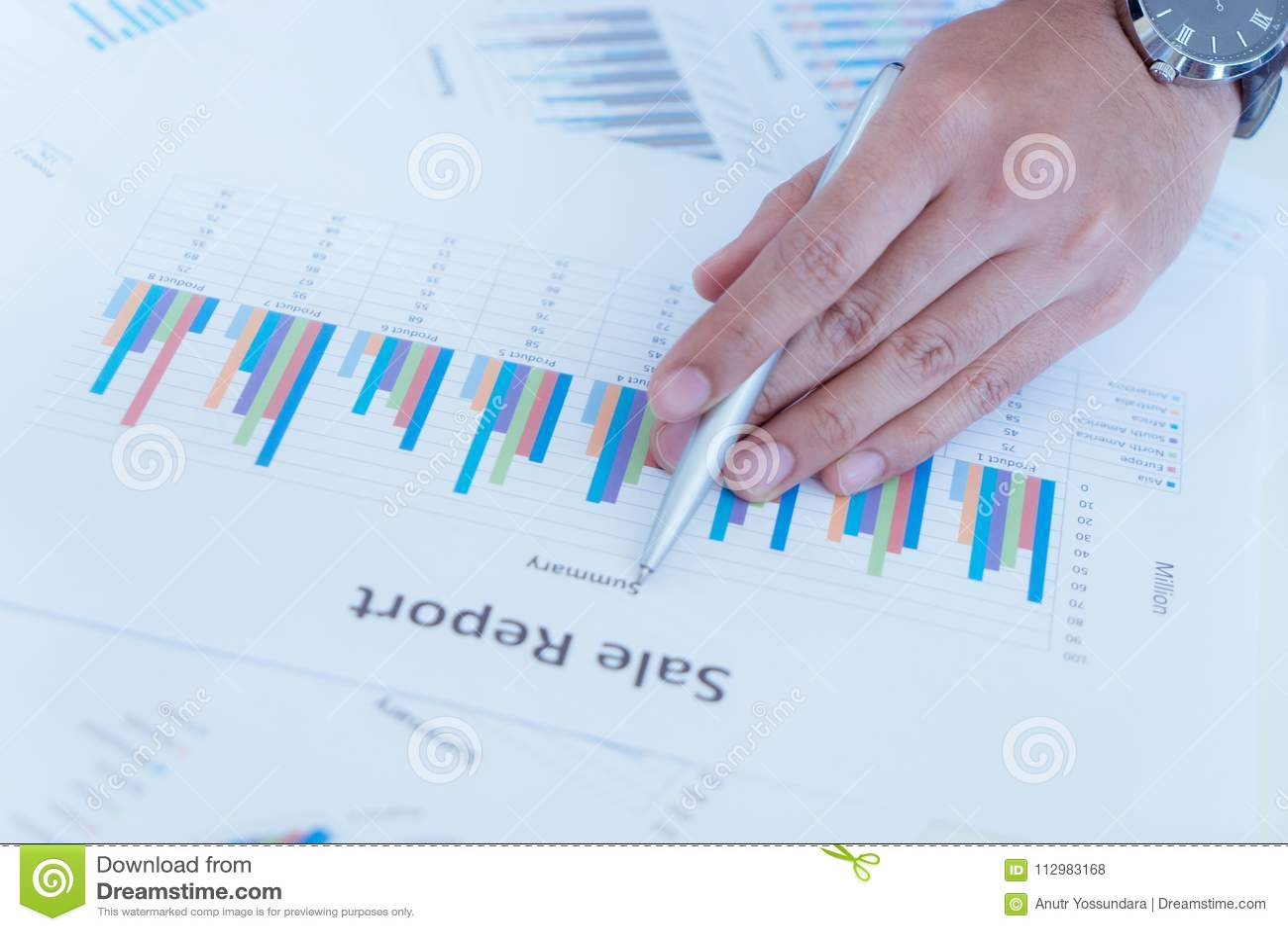 Business man marking on data sheet using pen