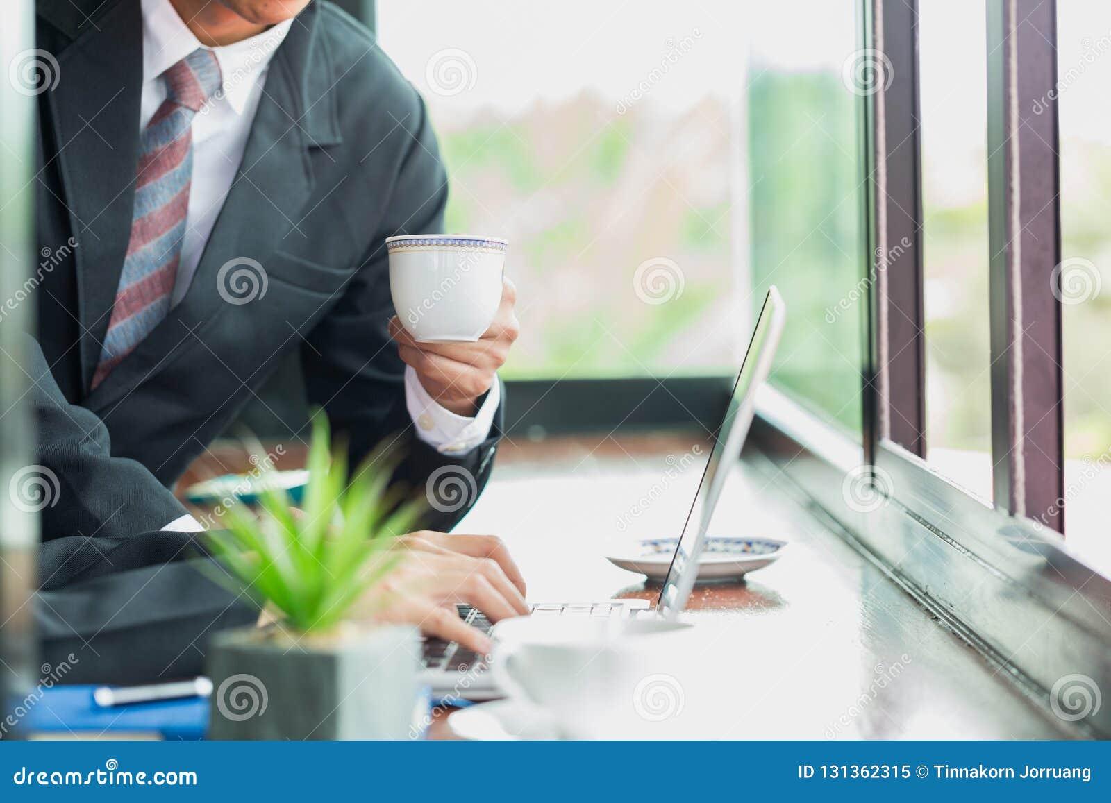 Business man at office desk working together on a laptop, teamwork concept