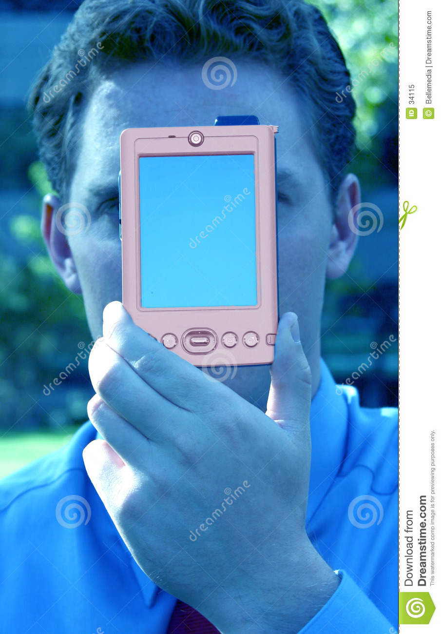 Business man with palm pilot