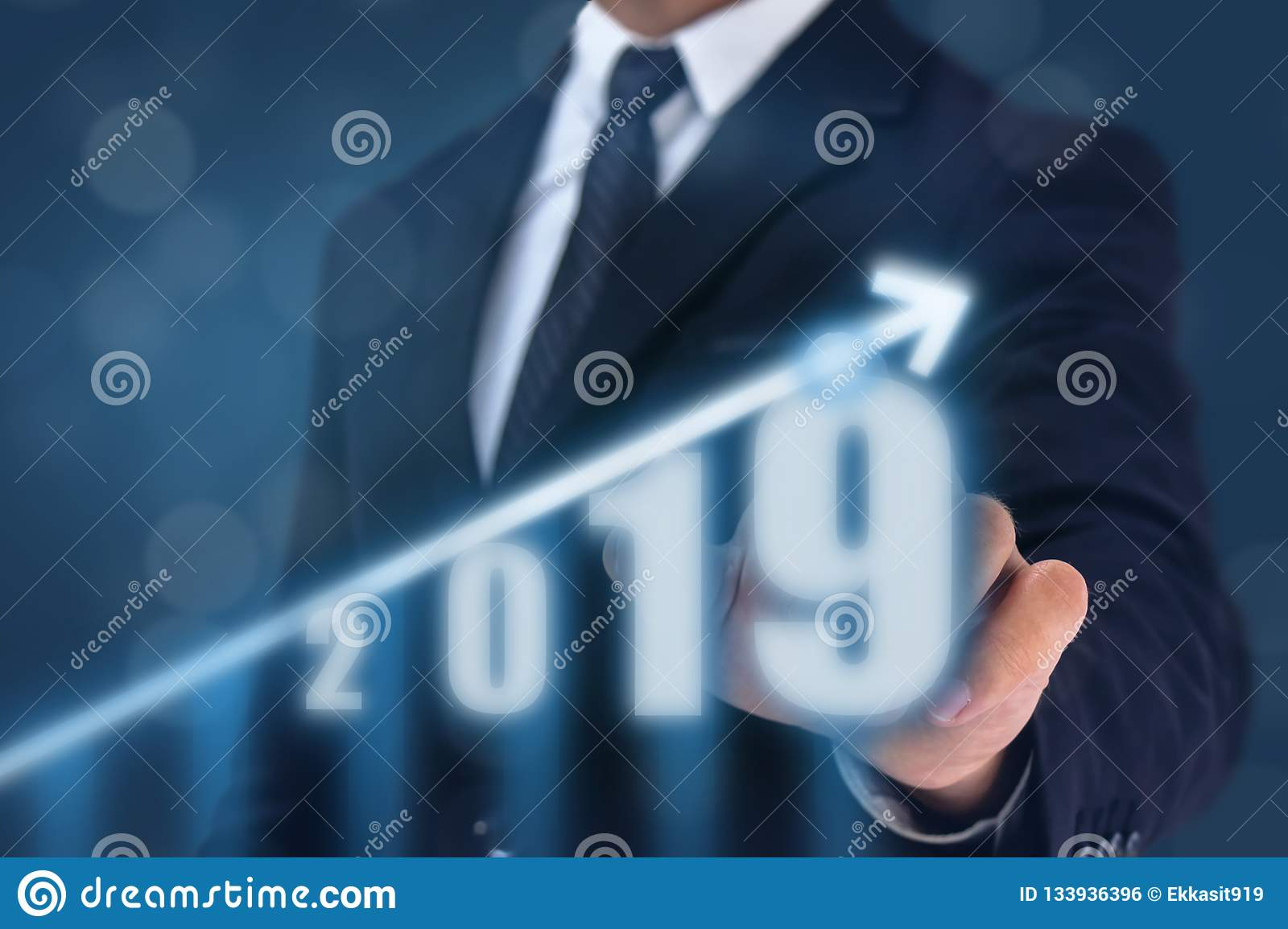 Business man point hand on the top of arrow graph with high rate of growth. The success and growing growth graph in the company or