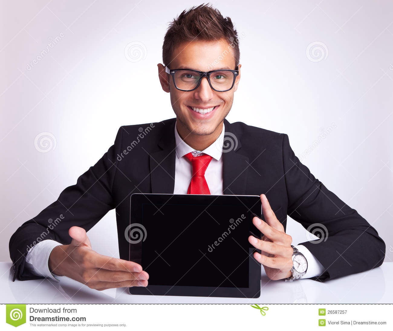 Business man presenting a touchscreen pad
