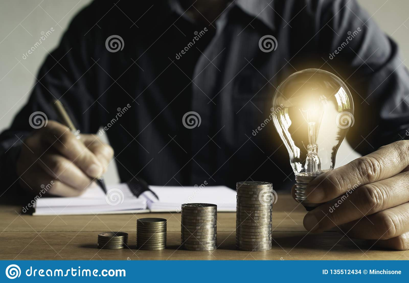 Business man putting a coin on coins stack saving bank and account for his money all in finance accounting concept