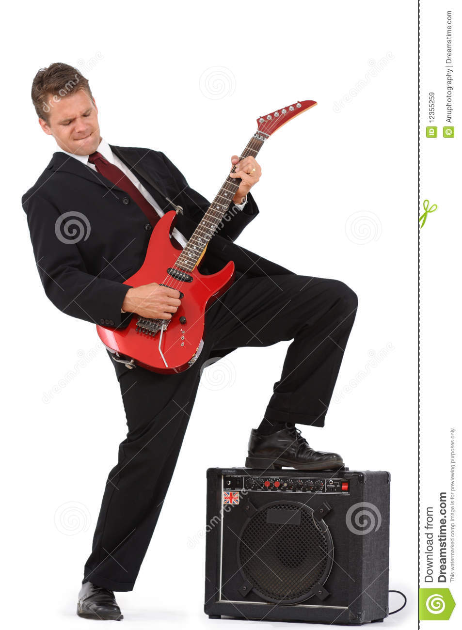 Business man rocking out on red guitar stock image