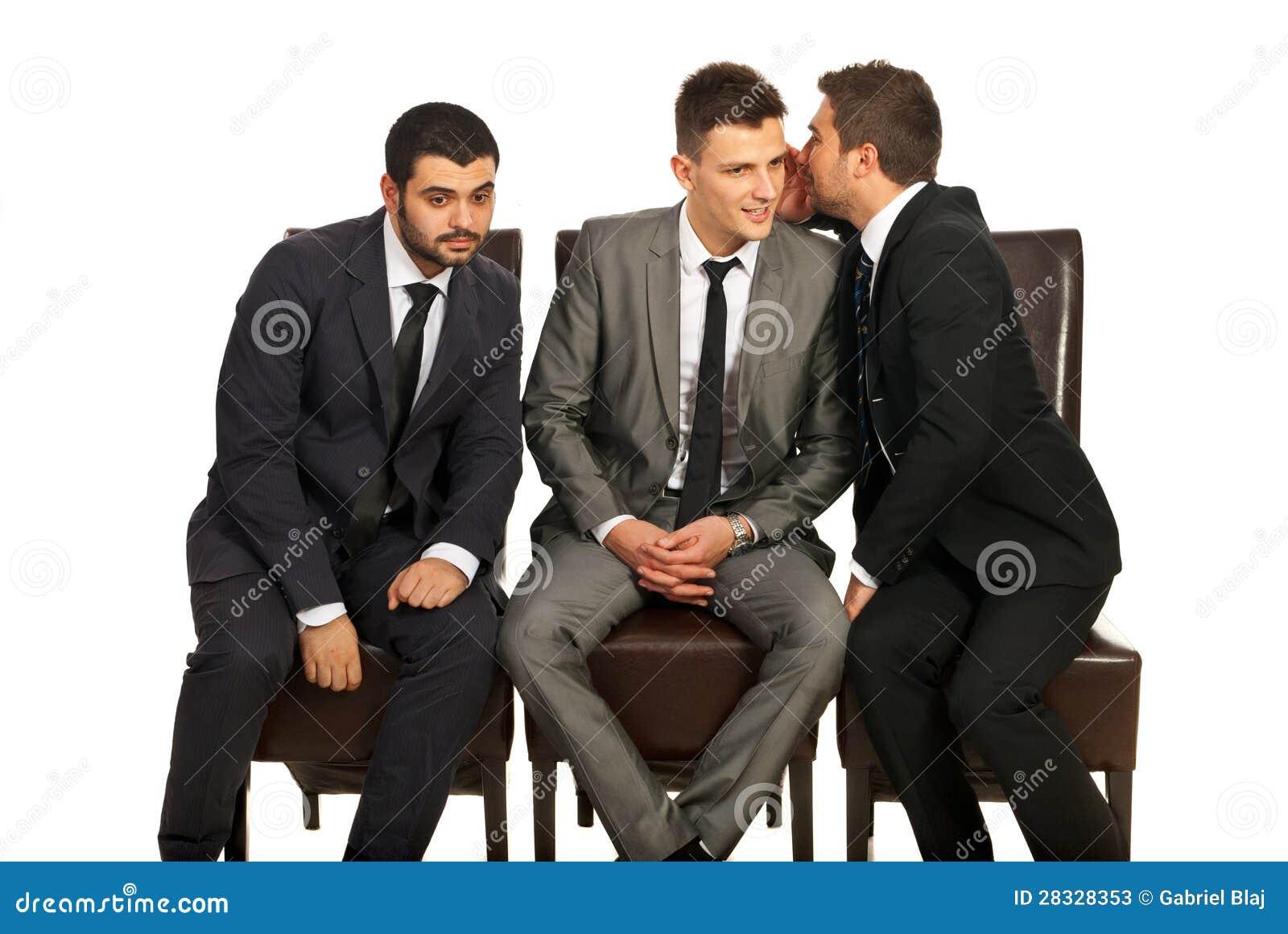 Business man sharing a secret