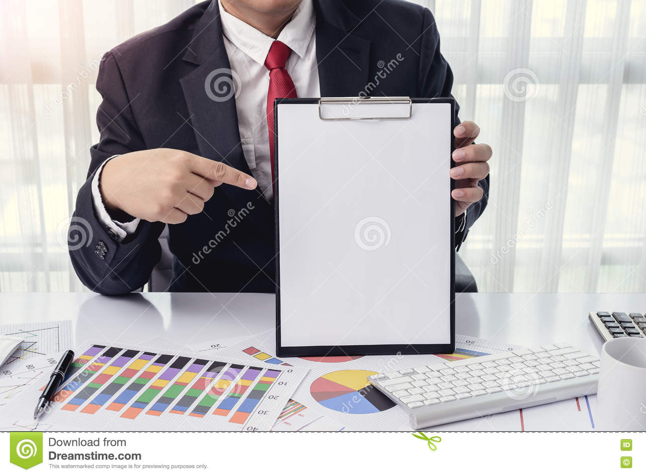 business man showing a blank paper at office with desktop comput