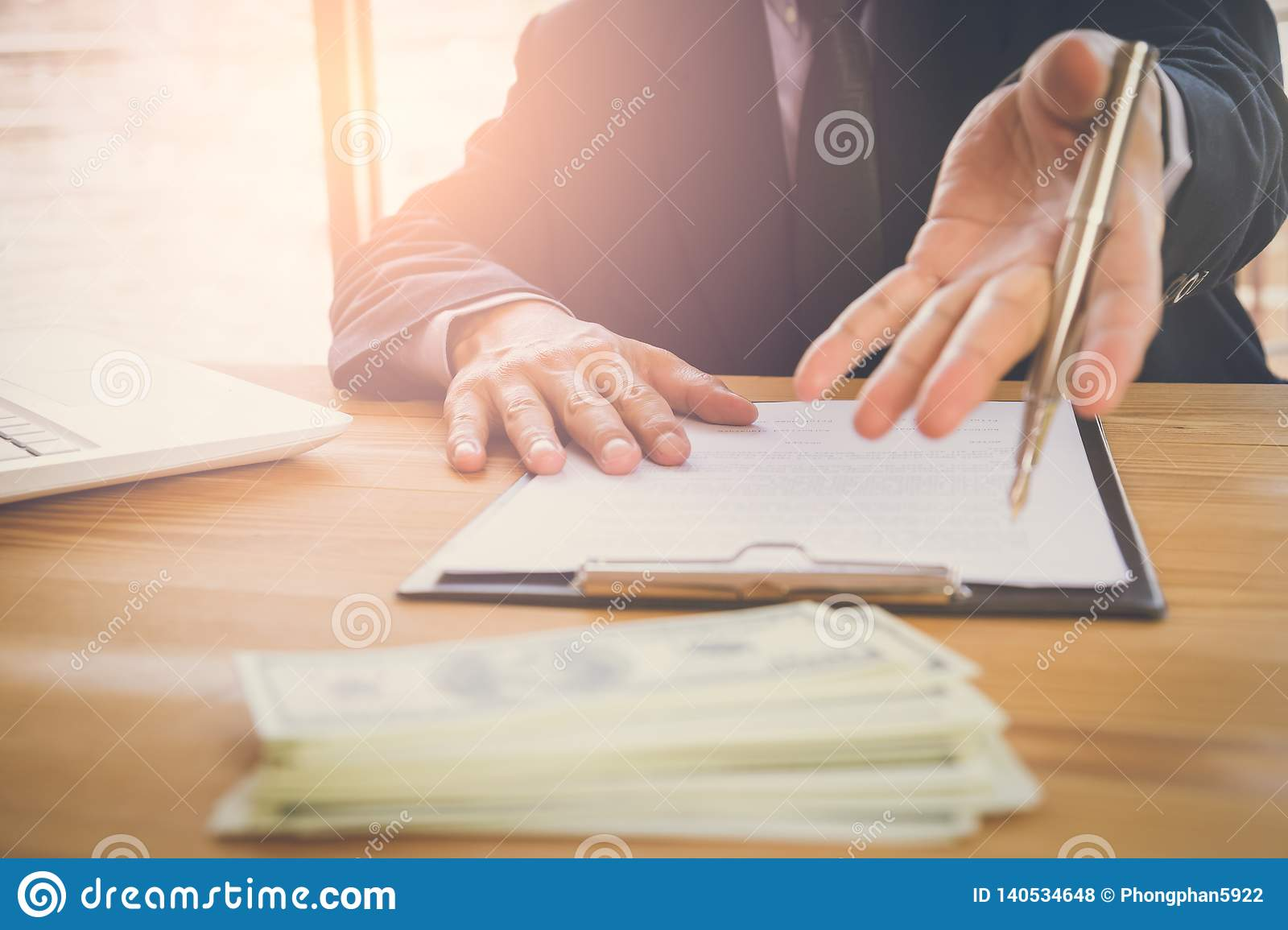 Business man signing a contract. Owns the business sign personally, director of the company, solicitor. Real estate agent holding