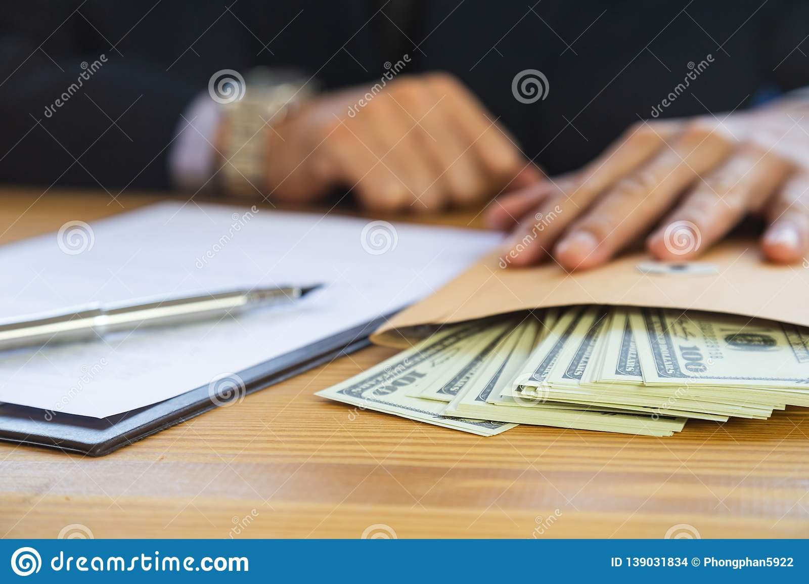 Business man signing a contract. Owns the business sign personally,director of the company, solicitor. Real estate agent holding