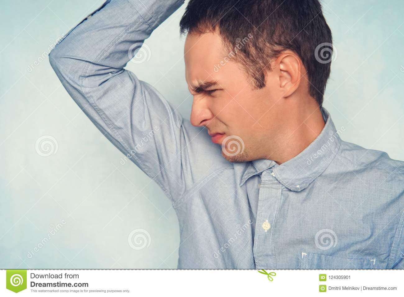 business man with sweating under armpit in blue shirt young guy