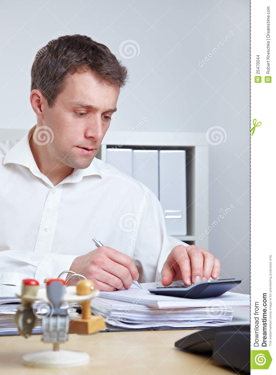 Business Man Using Calculator Stock Images Image 25470044