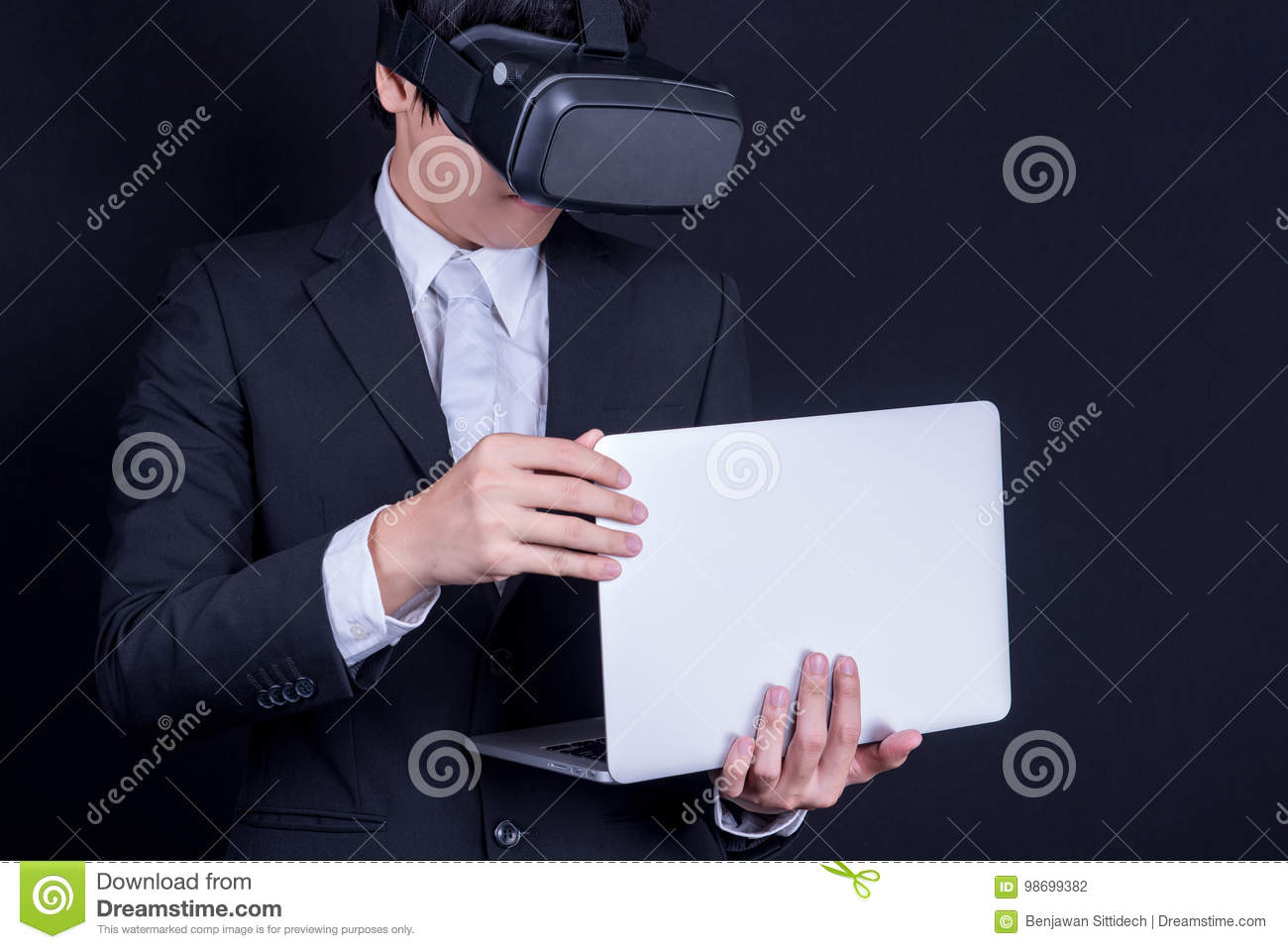 Business man wearing suit playing virtual reality goggles