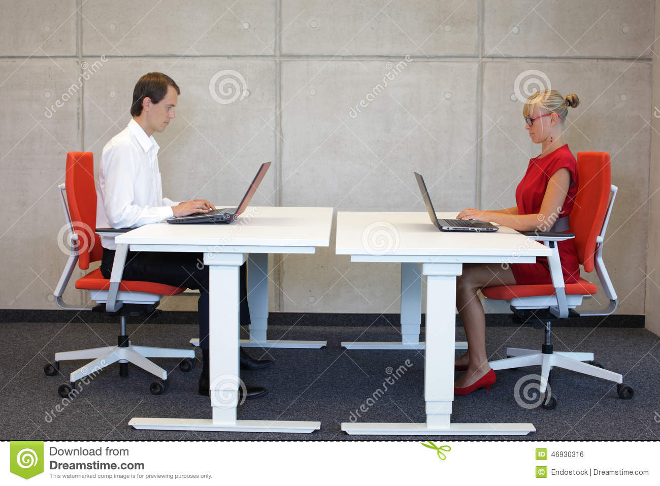 Business man and woman working in correct sitting posture with laptops sitting on chairs