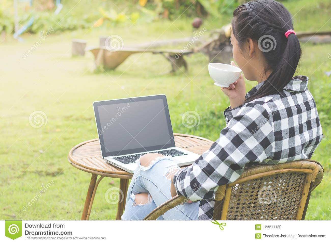 Business man working on laptop computer and drinking coffee in t