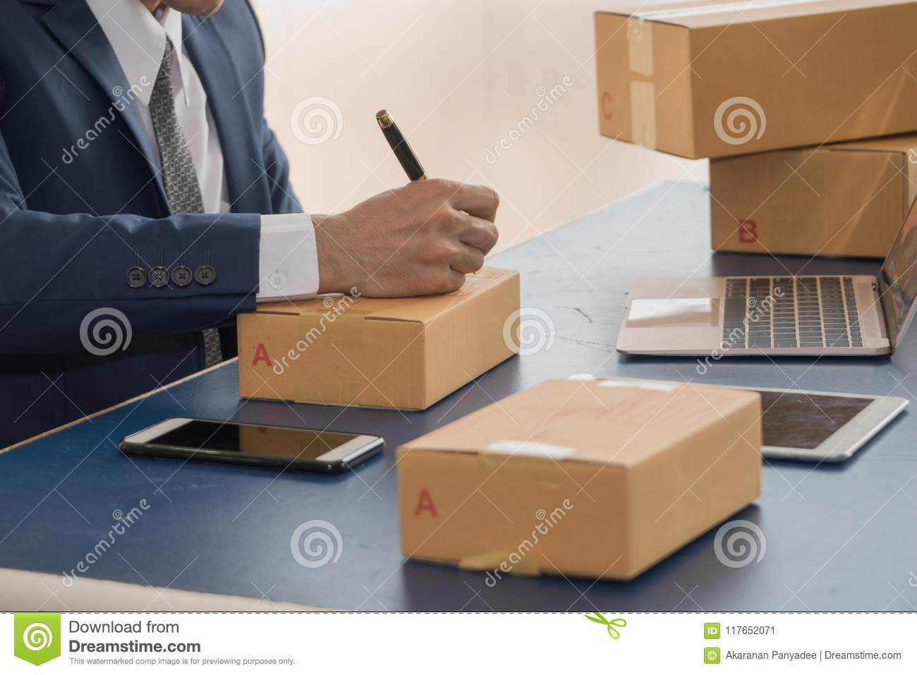 Business Man Writing Address On Package Sme Start Up Stock Image