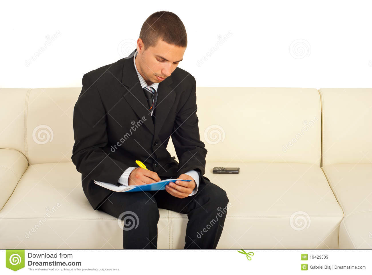 business man writing sitting sofa 19423503 Comparing Core Factors Of essay tiger reviews essaysrescue