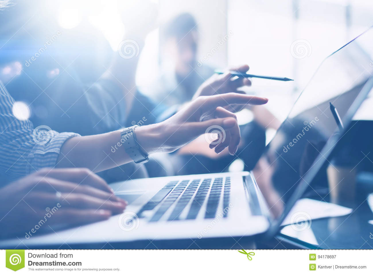 Business meeting concept.Closeup view of coworkers team working with mobile computer at modern office.Analyze business
