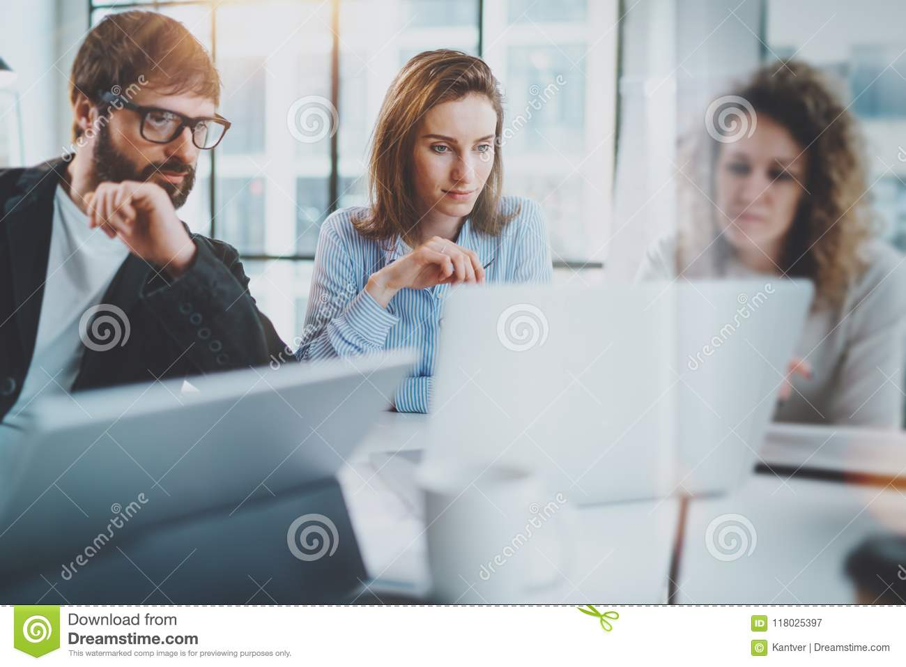 Business meeting concept.Coworkers team working with mobile computer at modern office.Blurred background.Horizontal.