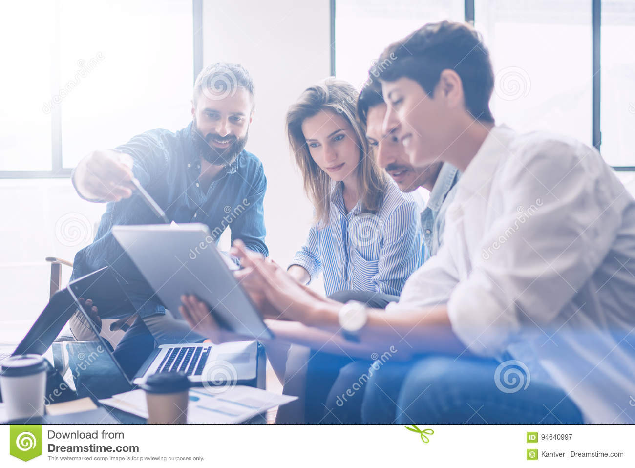 Business meeting concept.Coworkers team working new startup project at modern office.Analyze business documents, using