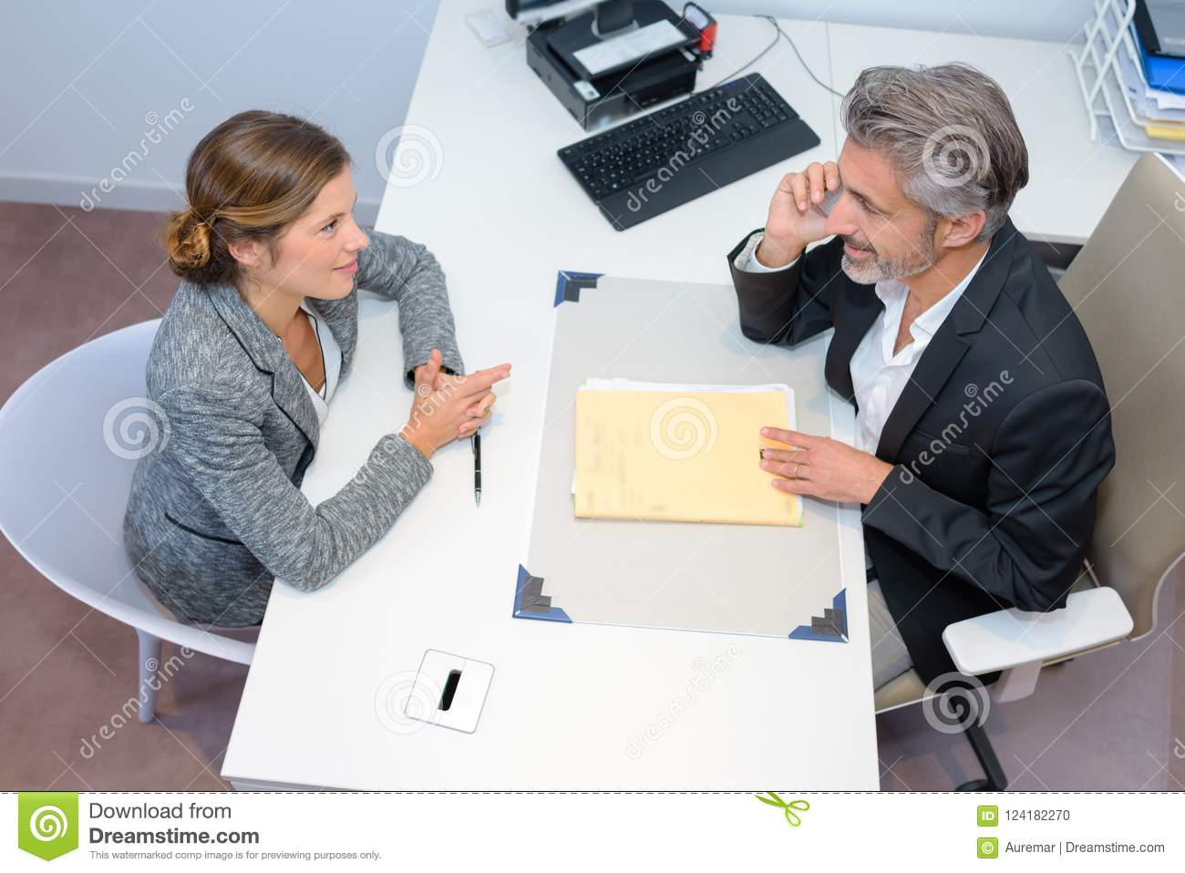 Business meeting discussing documents in office