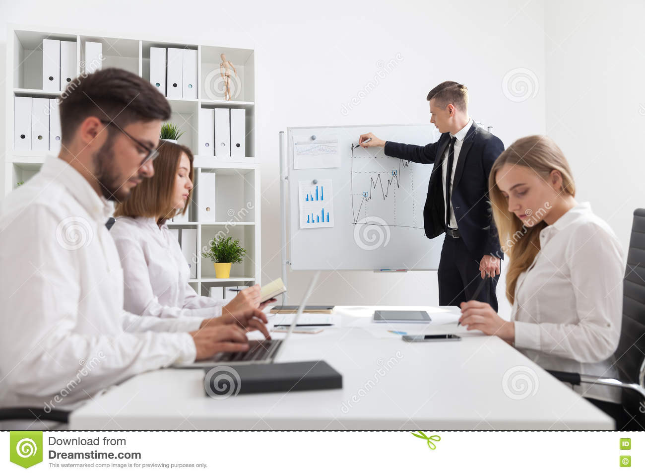 Business Meeting And Presentation Stock Image Image #0: business meeting presentation businessman explaining his work results to coworkers conference room concept office