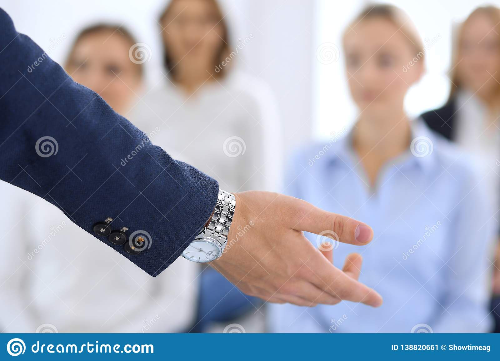 Business man making presentation to group of people. Speaker delivering a seminar to his colleagues or business training