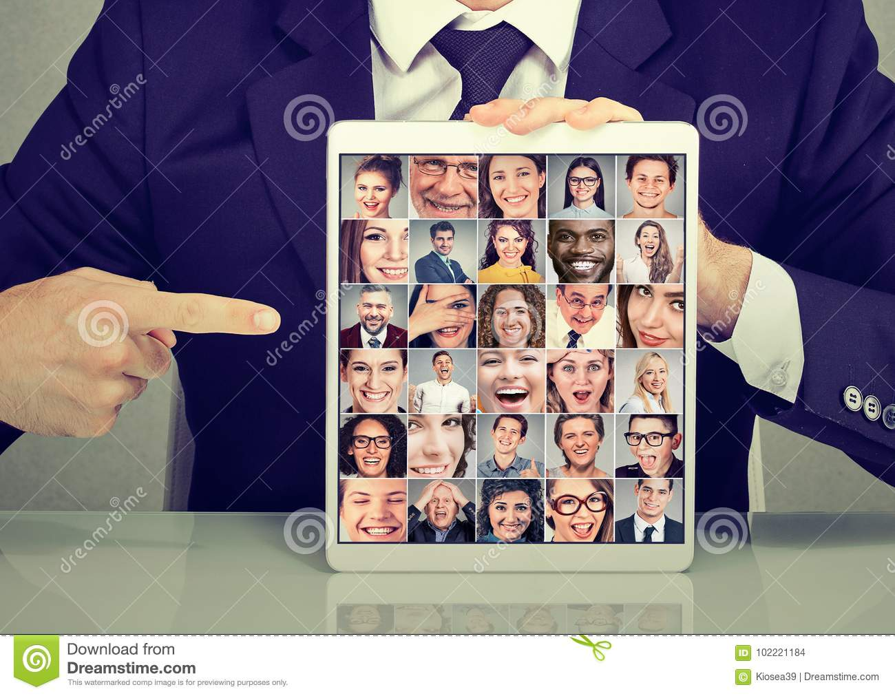 Business man with tablet advertising photo collection group of multicultural diverse people