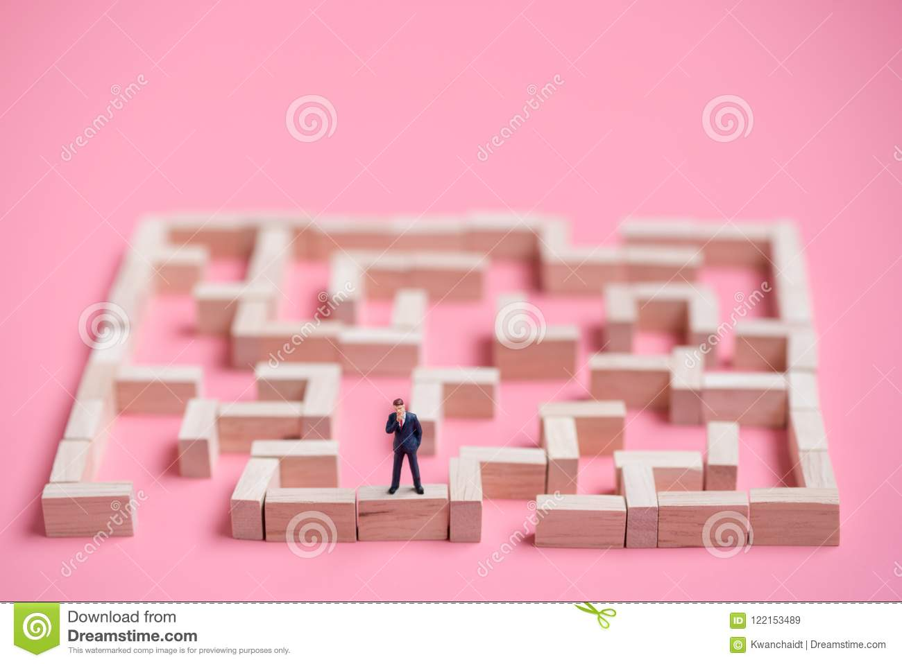 Business Miniature At The Start Point Of Puzzle Maze Wood Block