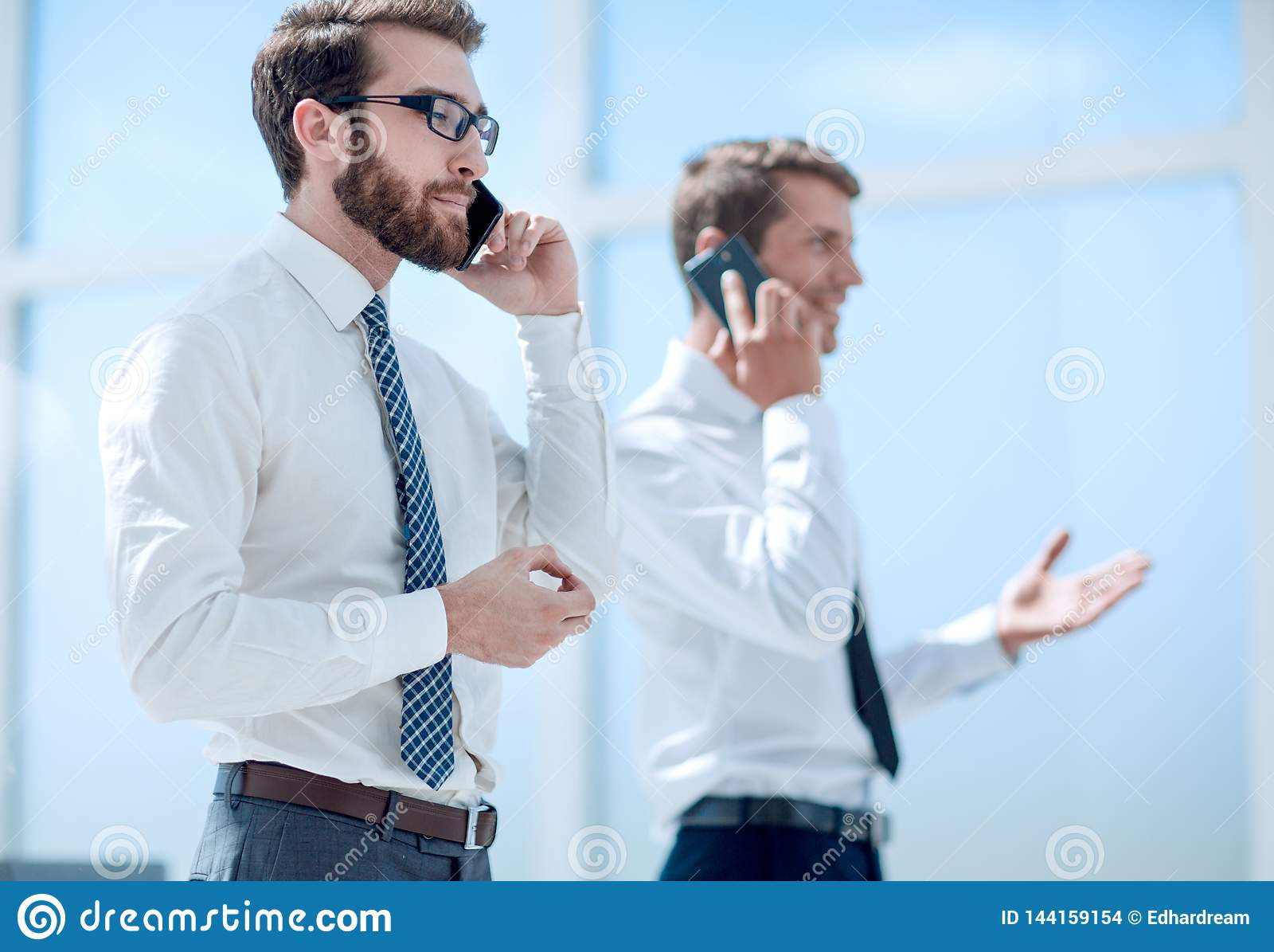 Business partners communicating using smartphones