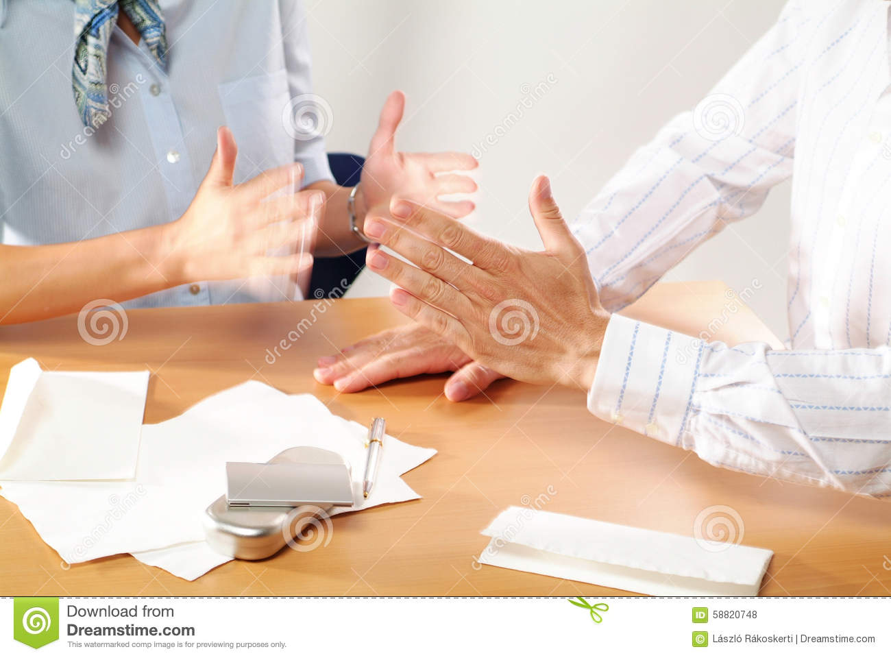 Business partners discussing hands