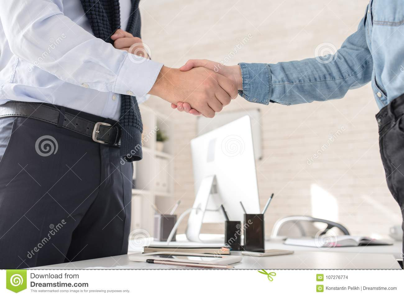 Business Partners Shaking Hands over Table