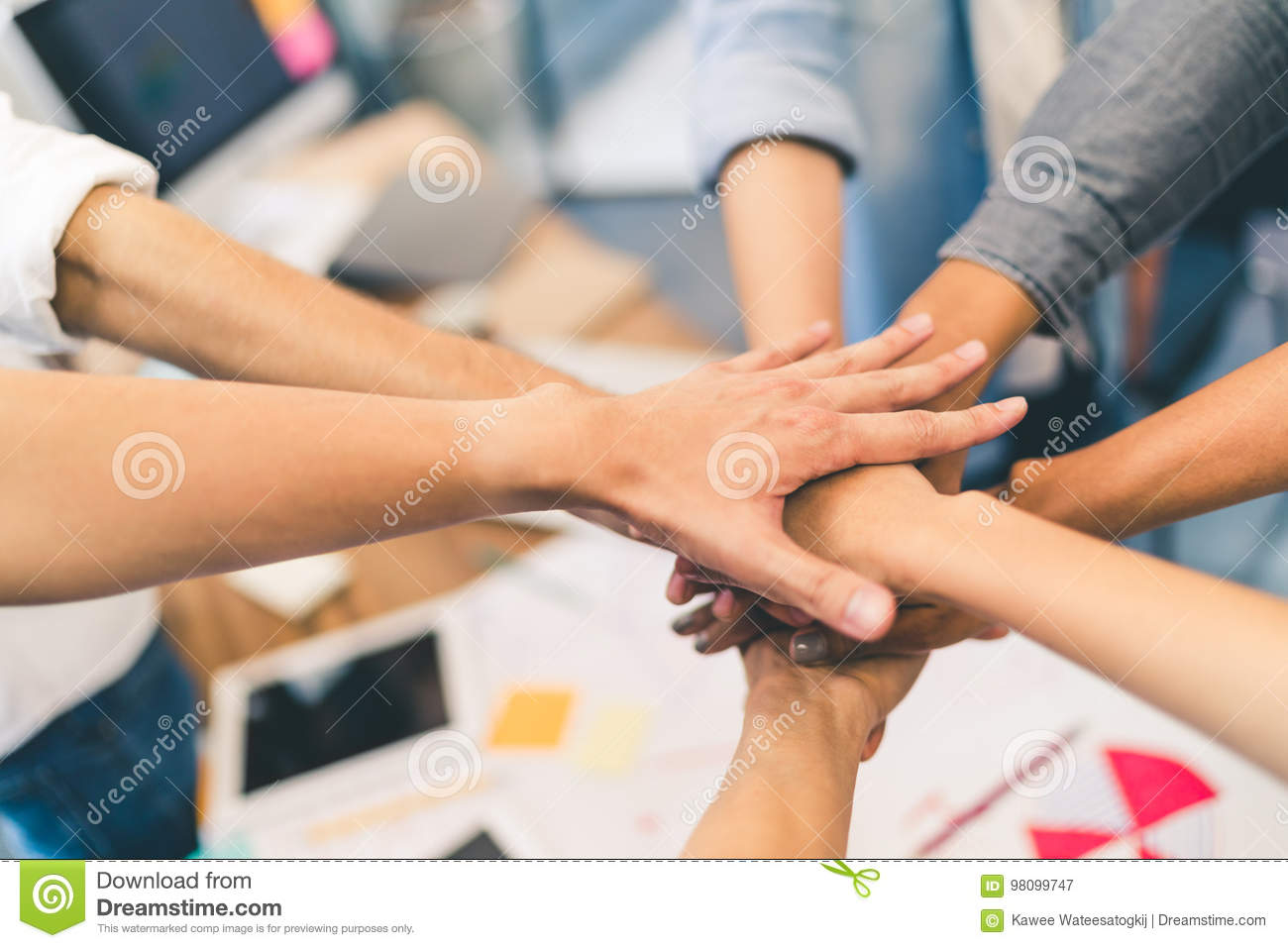 Business partners teamwork or friendship concept. Multiethnic diverse group of colleagues join hands together