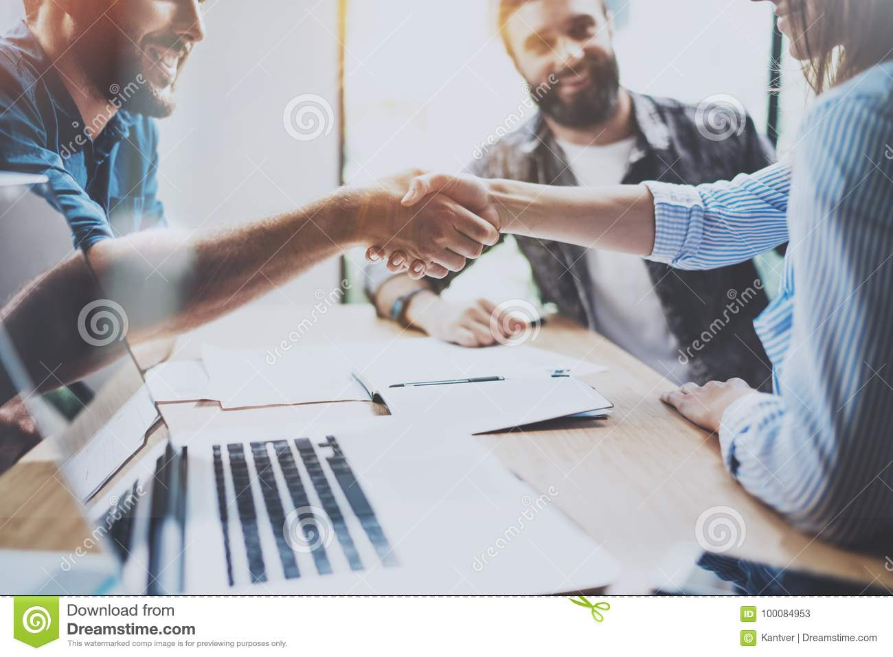 Business partnership handshake concept.Photo coworkers handshaking process.Successful deal after great meeting