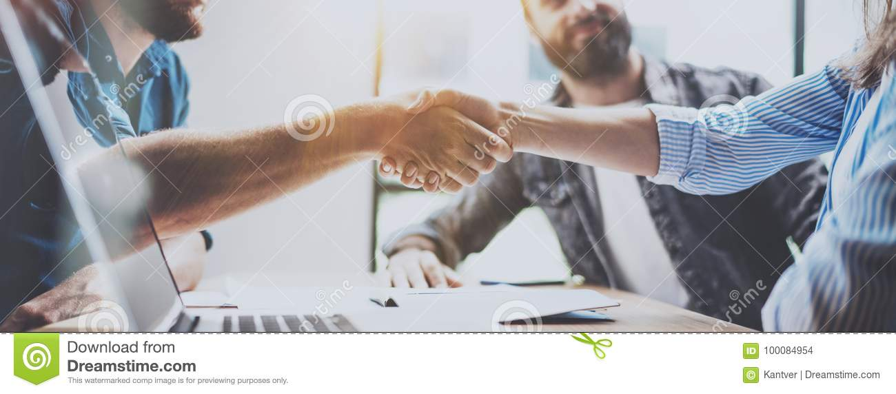 Business partnership handshake concept. Photo two coworkers handshaking process. Successful deal after great meeting