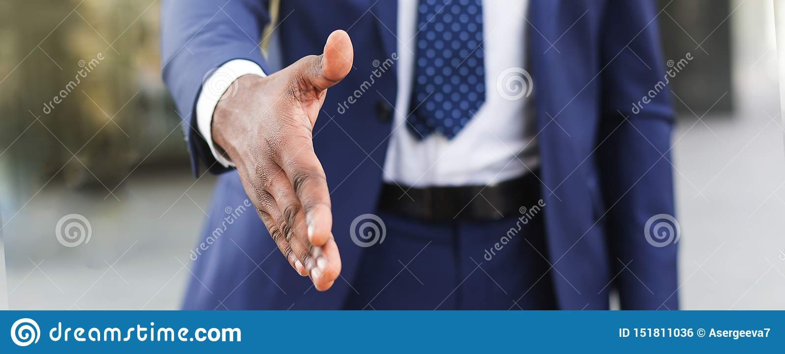 Business partnership meeting concept. Businesman extending hand for greeting