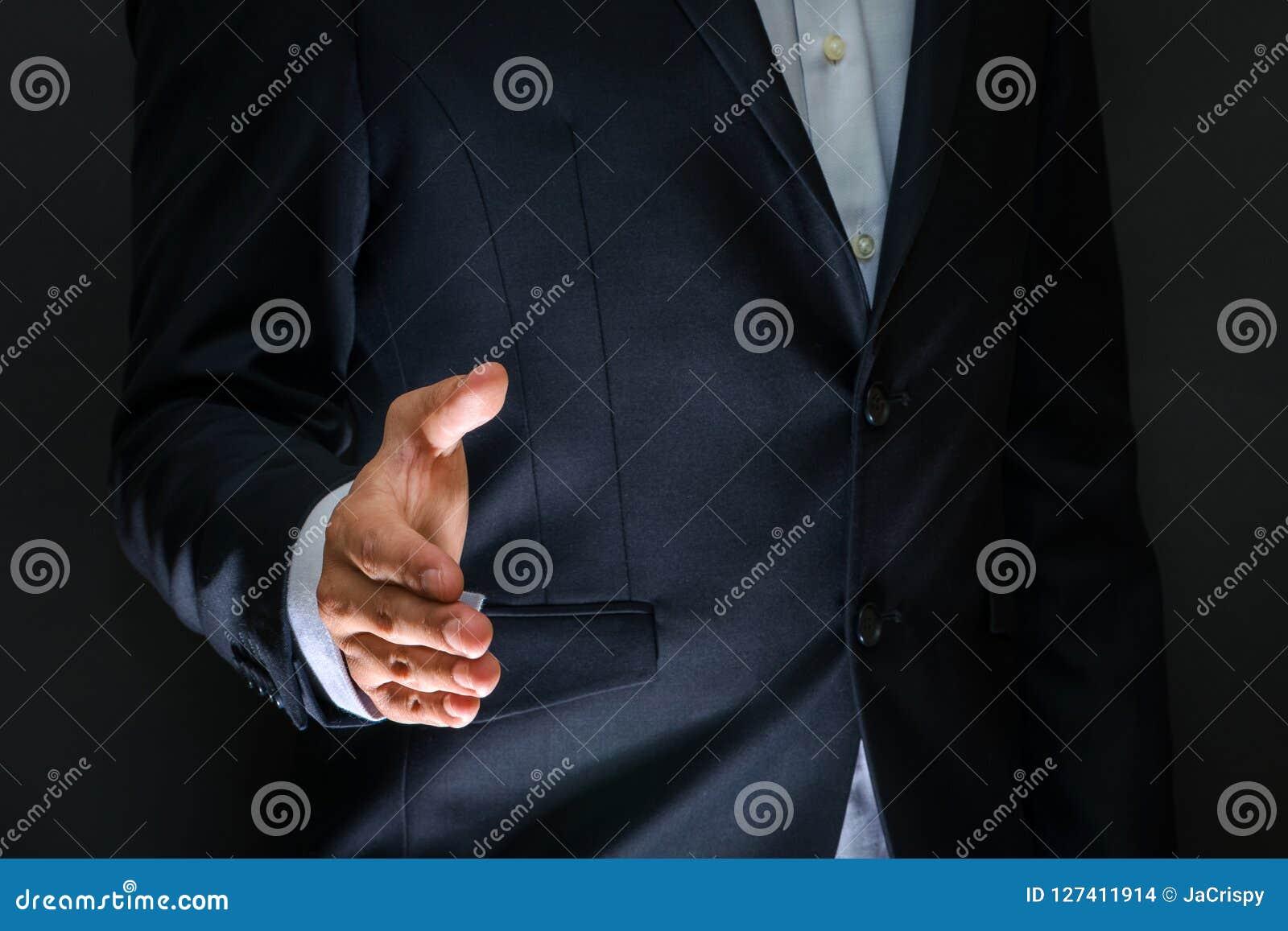 Business partnership meeting concept. Businessman handshake. Successful businessmen handshaking after good deal. Horizontal, blur