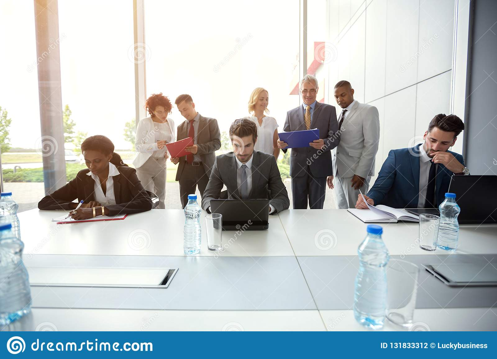 Business people analyzing management