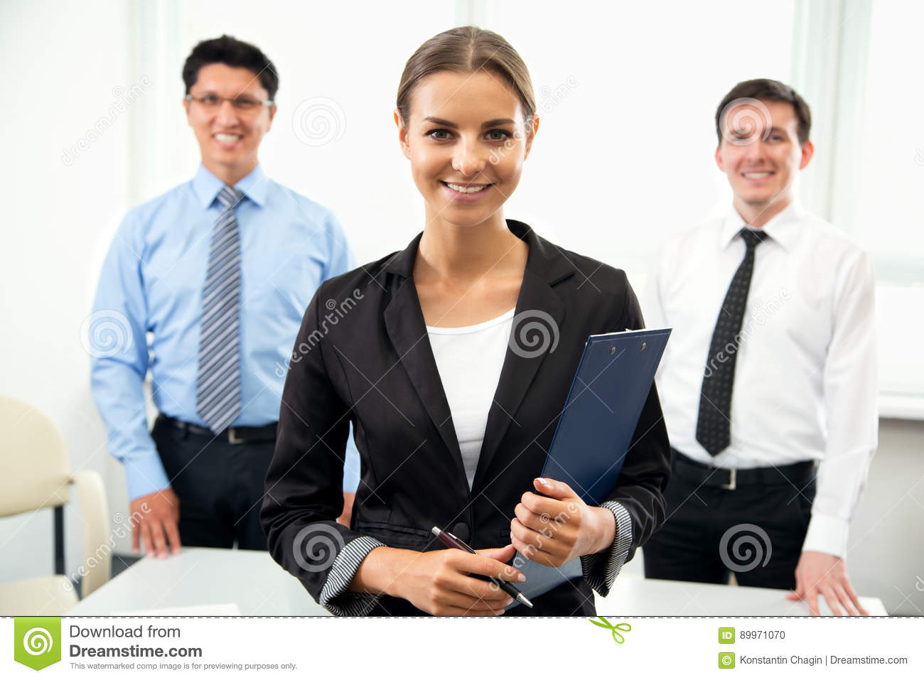 Business people with businesswoman leader