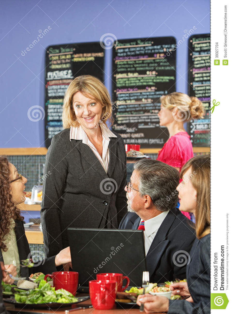 Business People In Cafe Talking Stock Photo - Image of