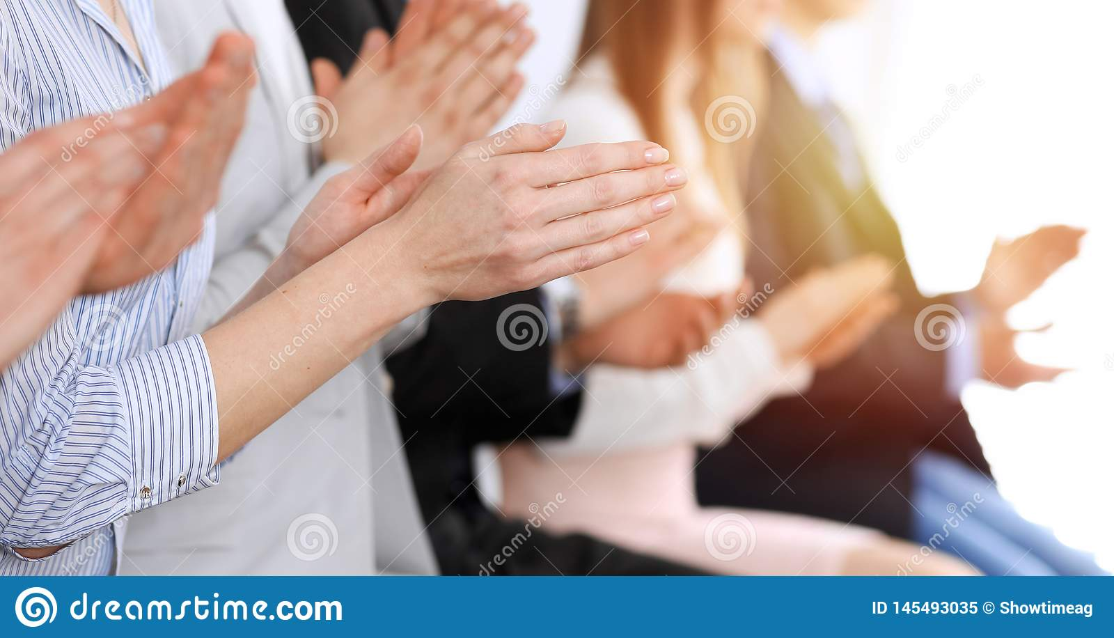 Business people clapping and applause at meeting or conference, close-up of hands. Group of unknown businessmen and
