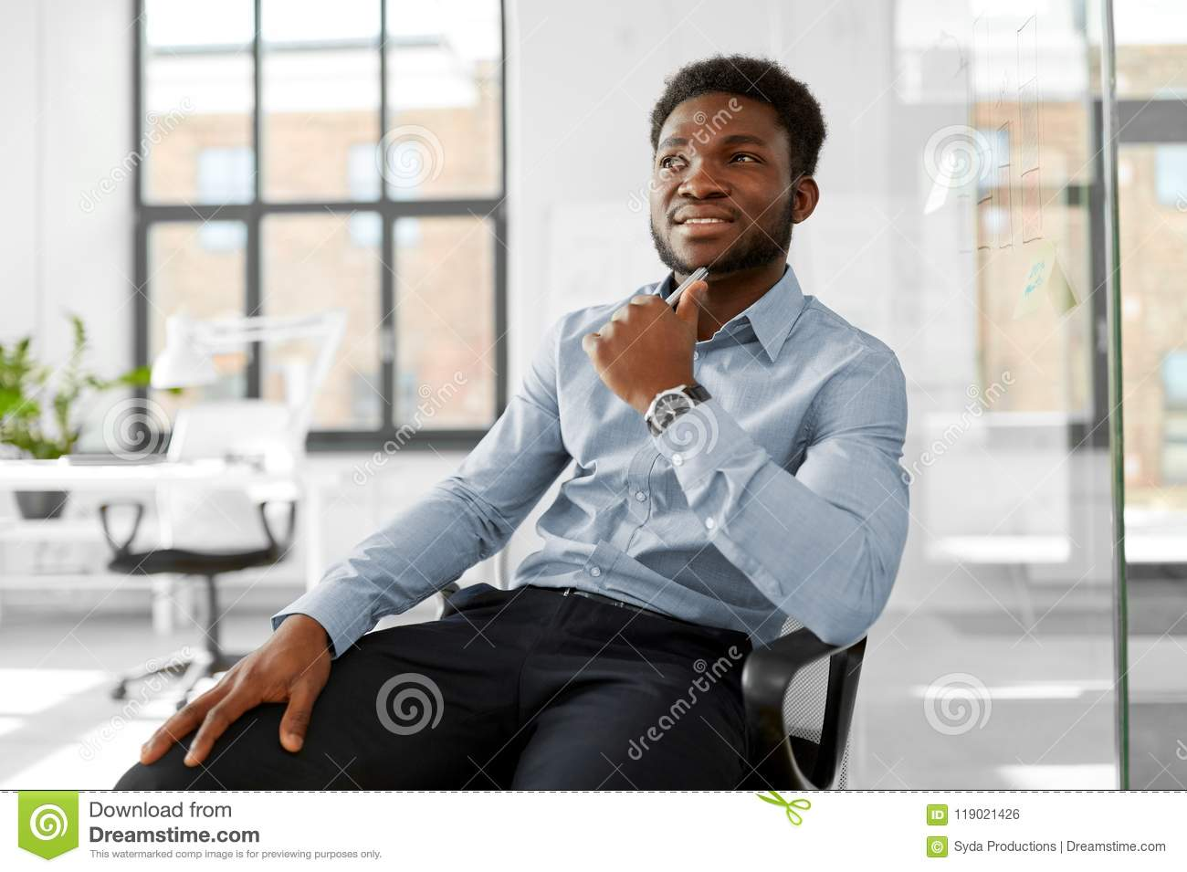 Download African Businessman Sitting On Office Chair Stock Photo - Image of male, african: 119021426