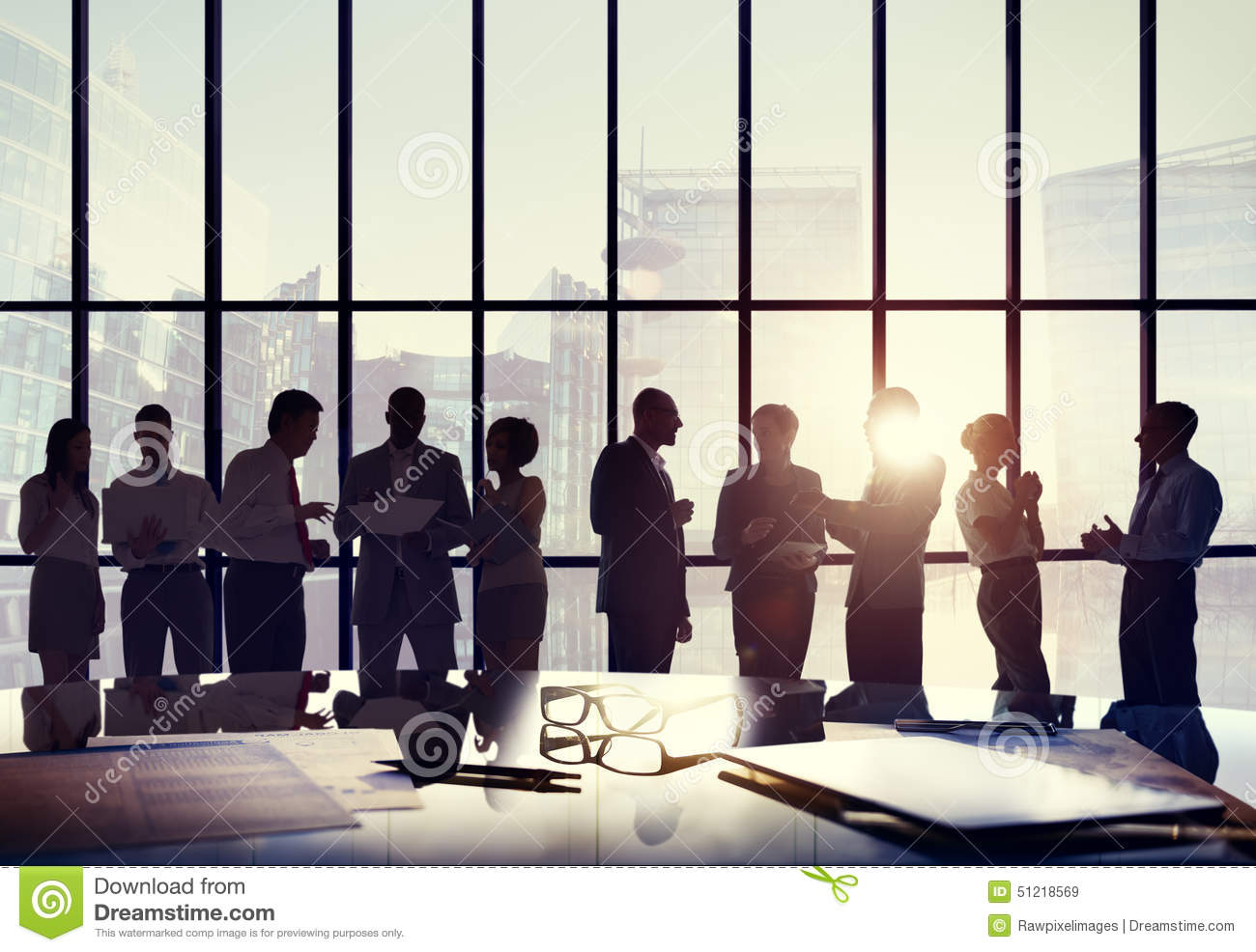Business People Confer...
