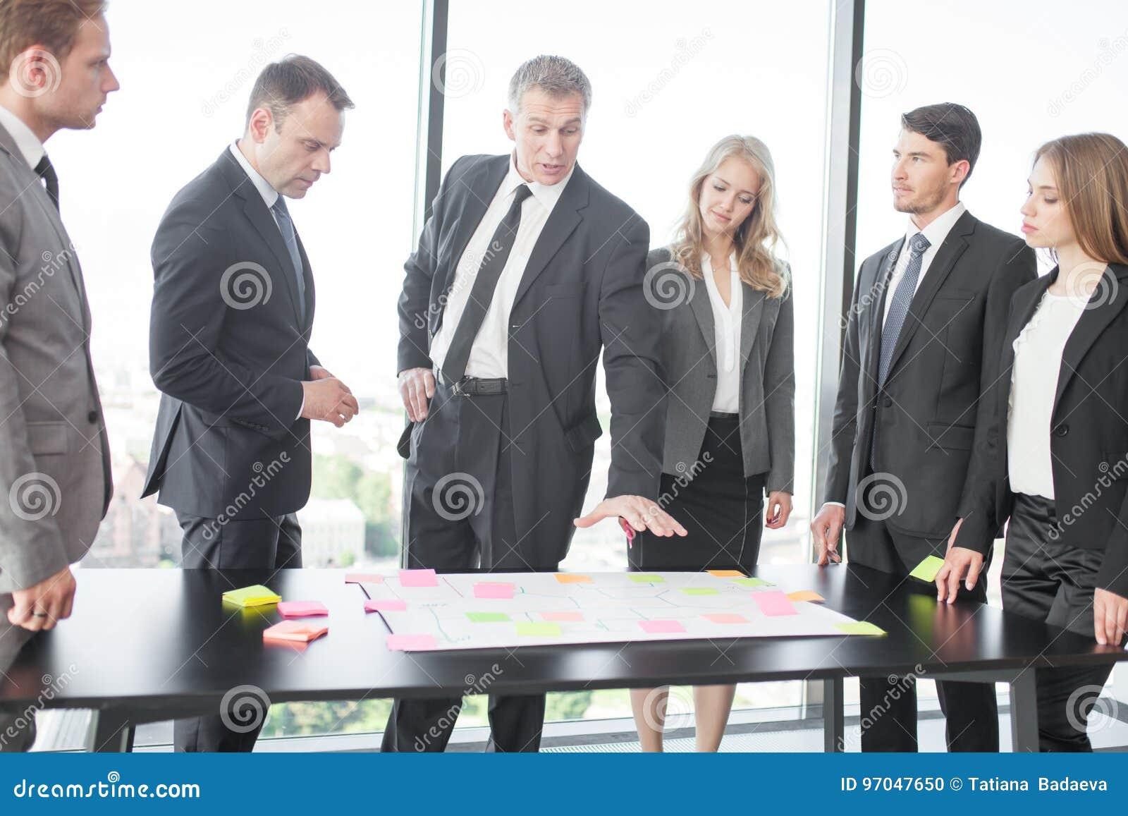 Business people developing plan on office desk
