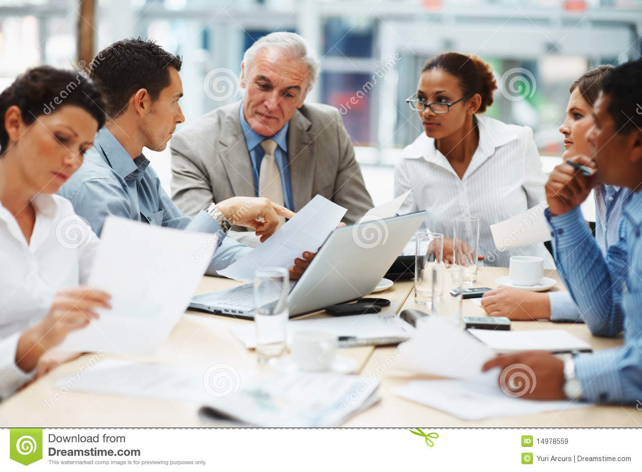 Royalty Free Stock Images: Business people discussing at a ...