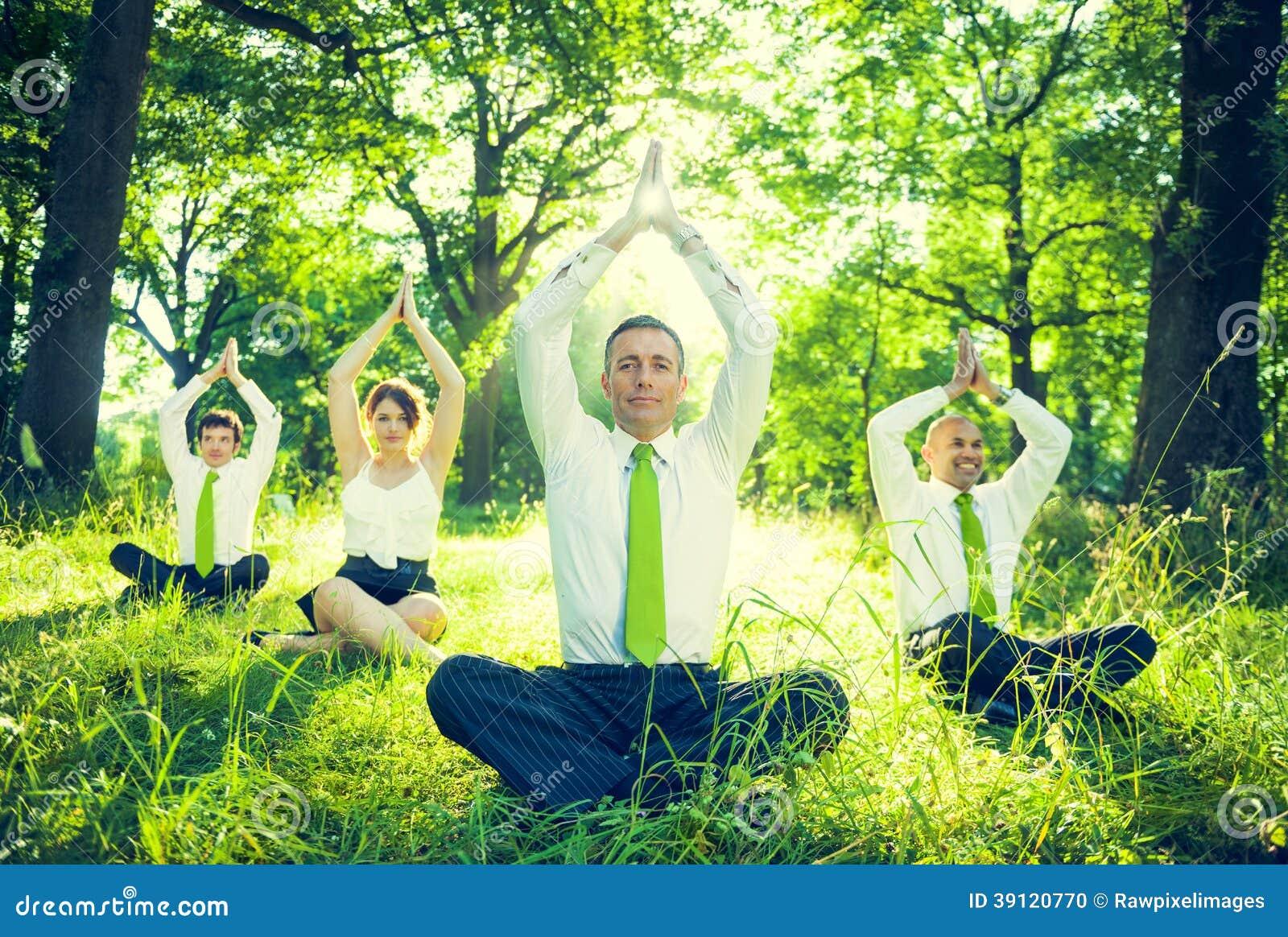 business people doing yoga stock photo