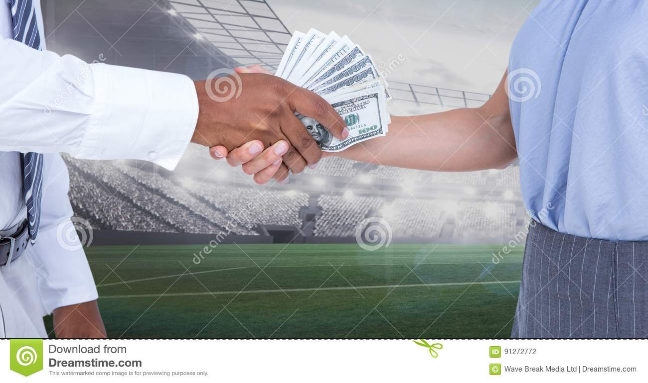 Business people exchanging money at stadium
