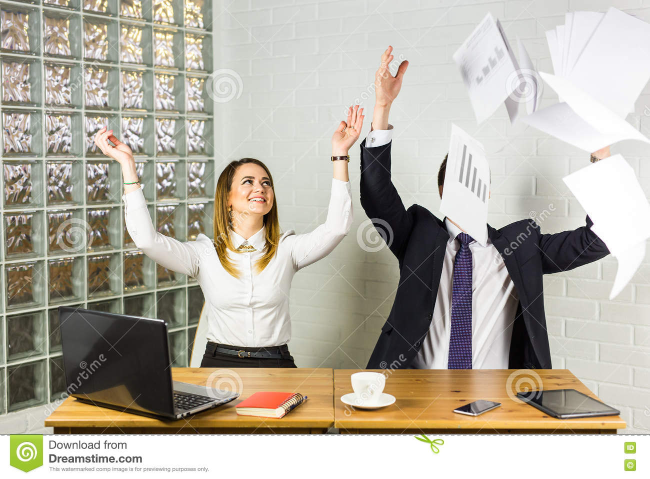 Business people excited happy smile, throwing up papers, documents fly in air, success team concept