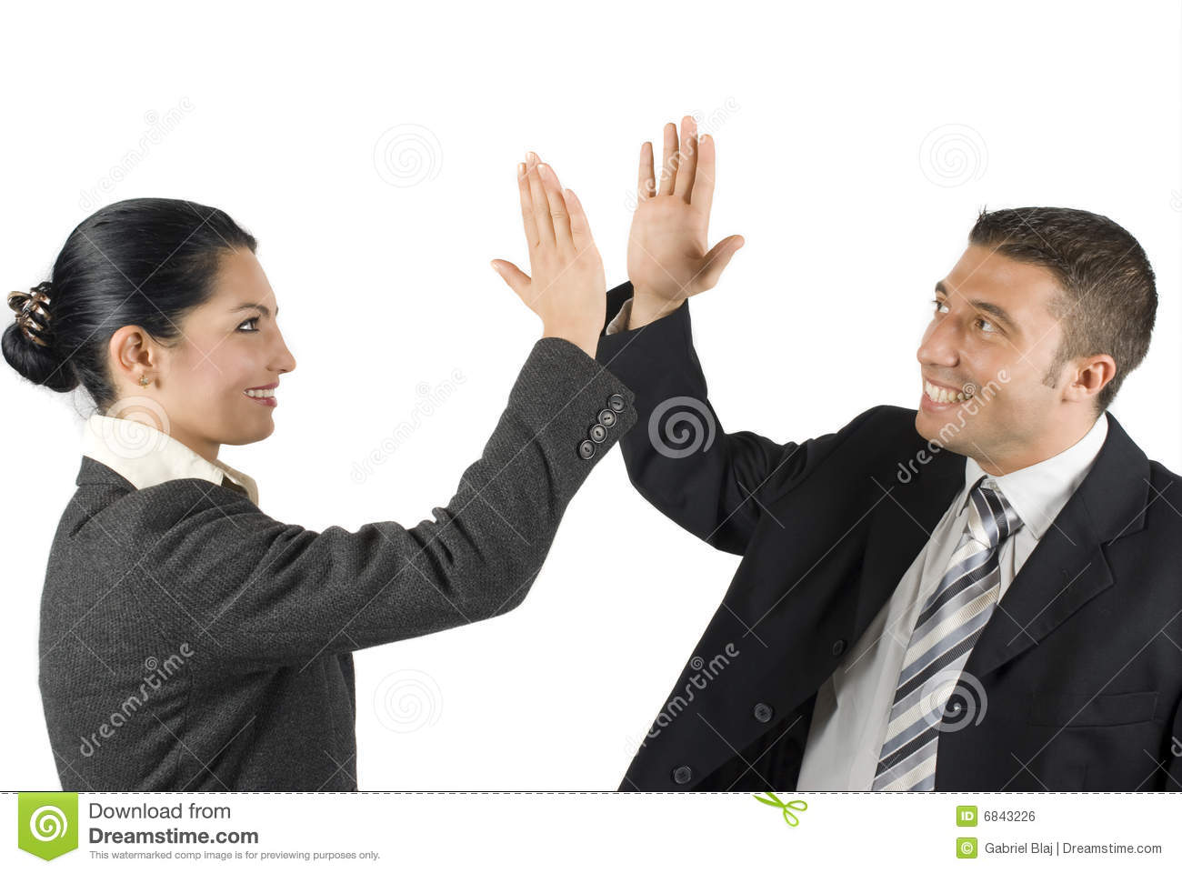 Business people give high five