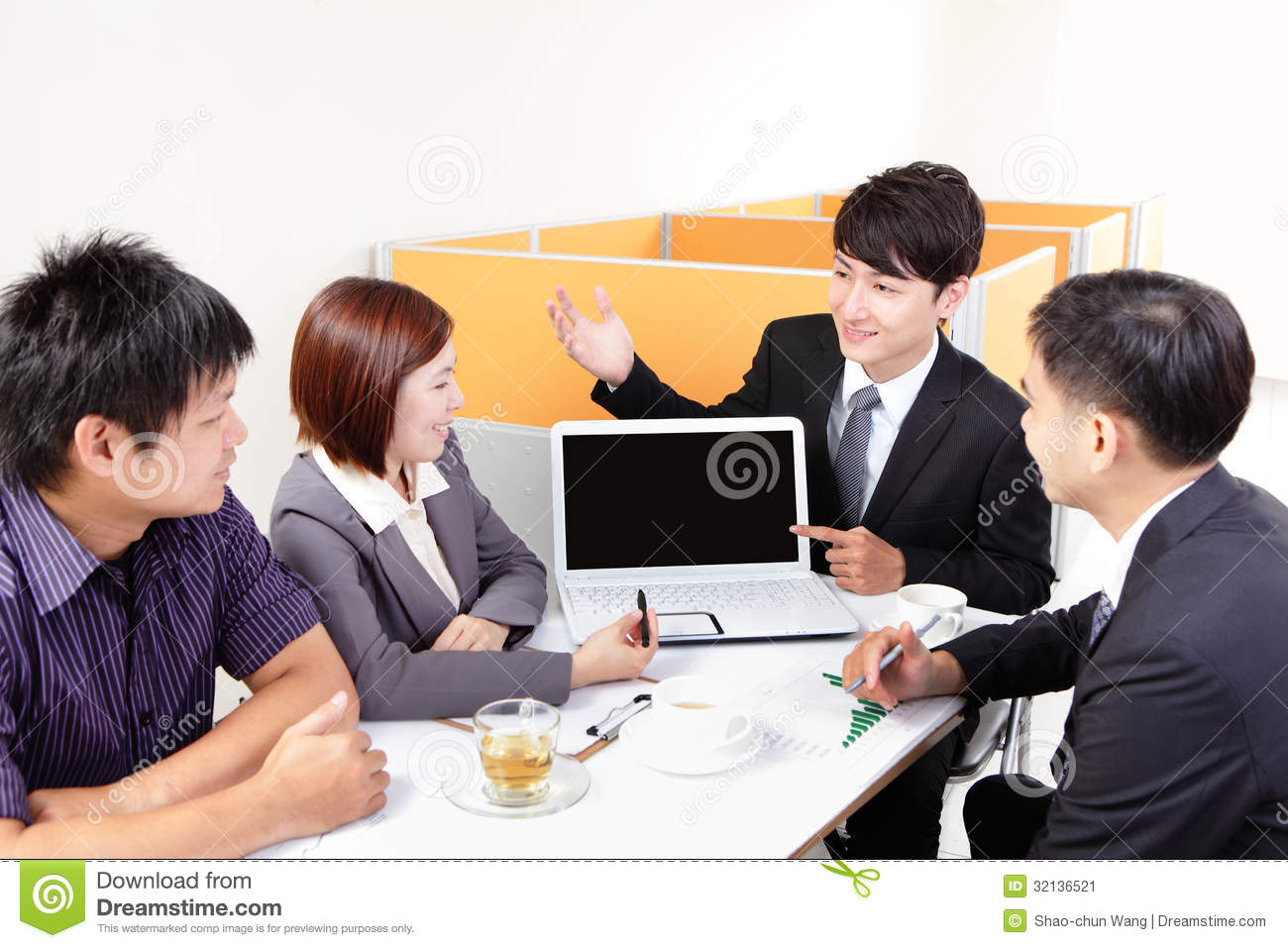Business people group meeting with computer