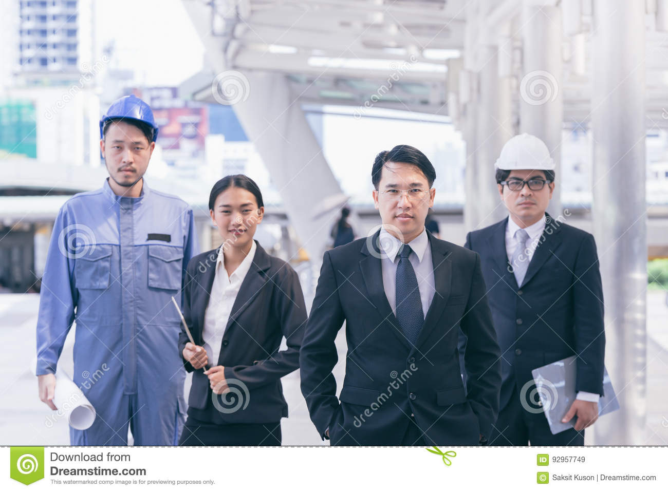 Business people group and Team management consulting with construction engineer architect and secretary working with safety hat